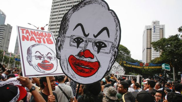 Student activists holds up a caricature of Malaysian Prime Minister Najib Razak in Kuala Lumpur in August.