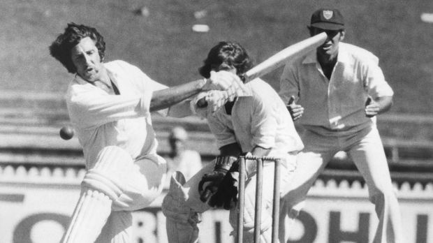Victorian cricketer Max Walker attempts to sweep New South Wales bowler David Hourn during a Sheffield Shield match at the Sydney Cricket Ground, 17 February 1976.