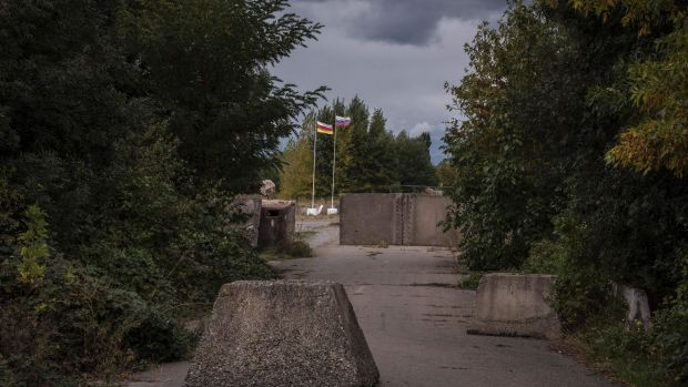"Concrete bollards mark the ""border"" between Georgia and the breakaway region of South Ossetia outside Gori, Georgia. The ..."