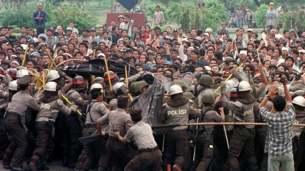 Indonesian anti-riot police try to push a group of students during a protest against rising prices and unemployment.