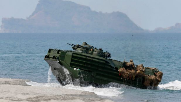 A US Navy amphibious assault vehicle with Philippine and US troops on board storms the beach at a combined assault ...
