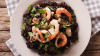 HFWNXP Black rice with shrimp, calamari, mussels and scallops on the plate closeup. Horizontal view from above satmay19eurofood 4/ Barcelona ? arroz negro ? black rice with cuttlefish at Carles Abellan?s La Barra in Barceloneta www.carlesabellan.com