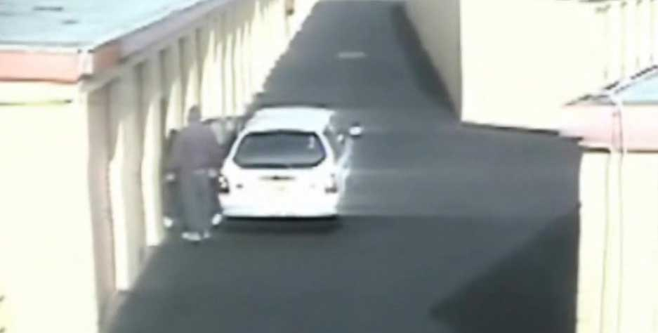 Gao getting out of a white Ford station wagon cctv still