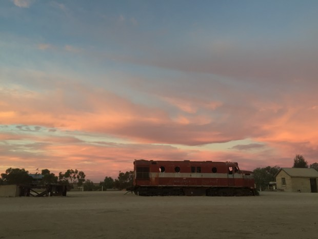 Sunset over old train carriage in Marree