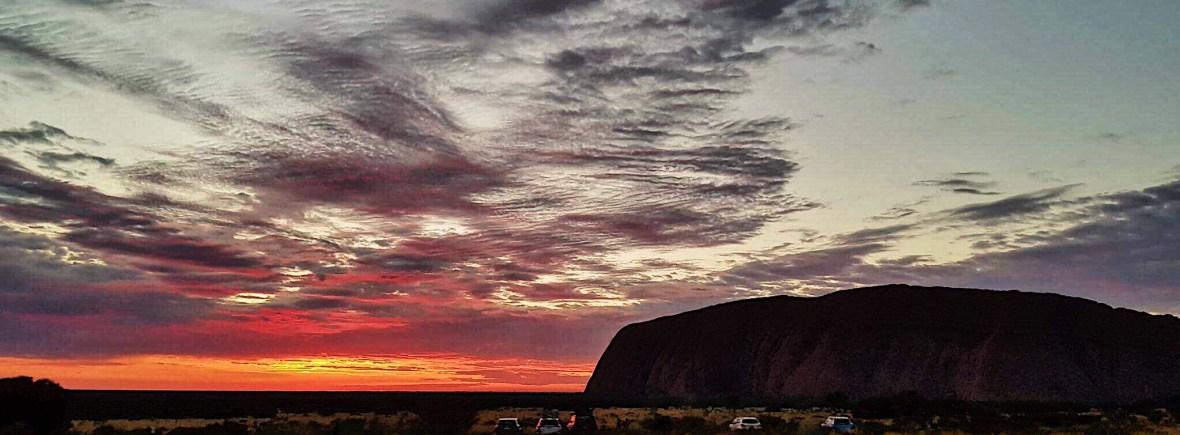 Silhouette of Uluru at sunrise