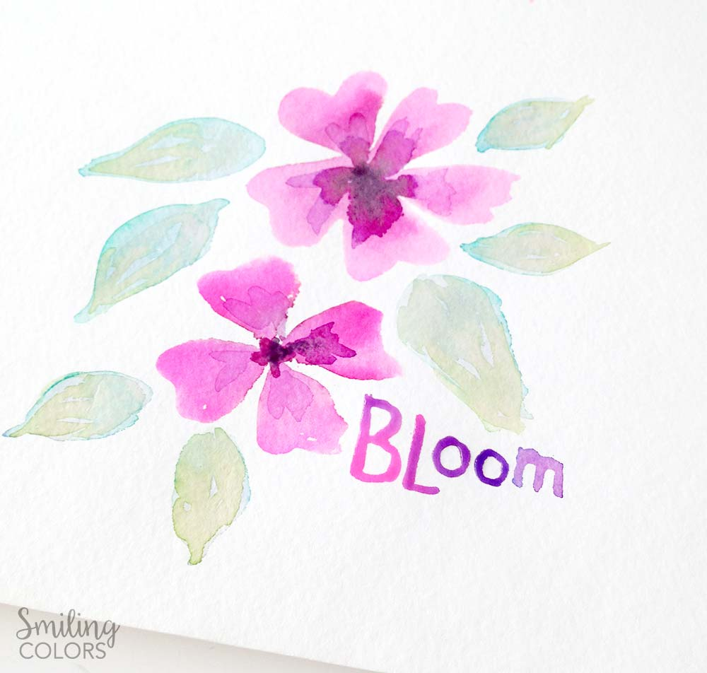 Easy watercolor flowers tutorial, dropping color onto wet paper