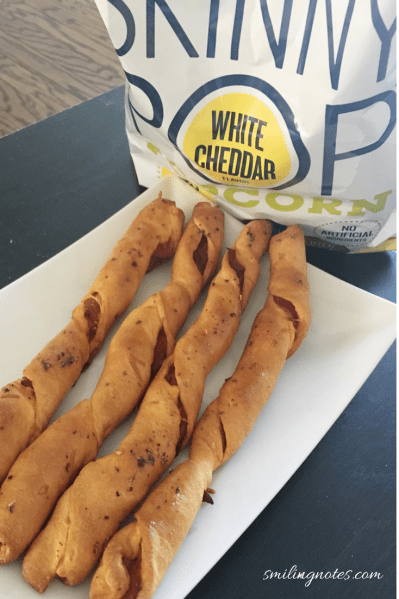 Pepperoni pizza twists paired with some delicious Popcorn makes for a perfect party appetizer!