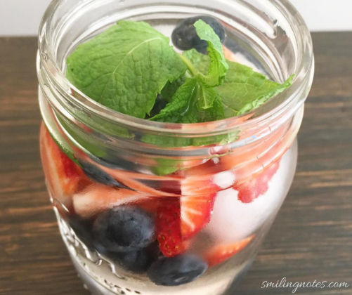 fruit infused water with berries and mint
