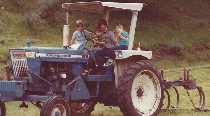Vintage Smith family on a tractor.