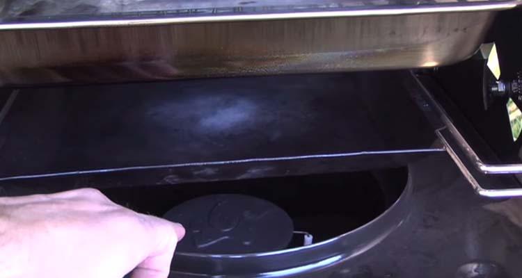 Smoke vault burner
