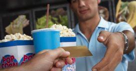 teen buying popcorn