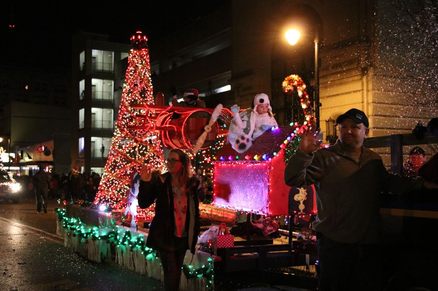 SMWC s student led parade spreads holiday cheer   SMWC Parade float covered in lights with lifesize toy airplane on top
