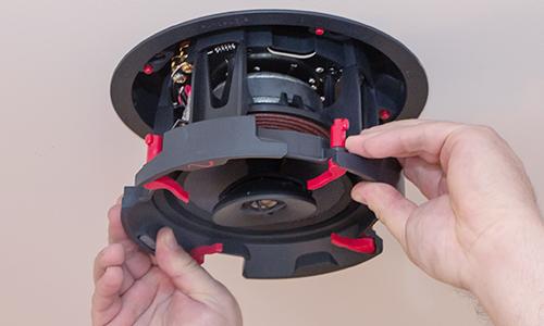 Dealer installing in-ceiling speaker