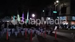 Advertisement, Architecture, Asphalt, Barricade, Bazaar, Building, City, Crowd, Fence, Flare, High Rise, Human, Indoors, Interior Design, Light, Lighting, Market, Nature, Night Club, Night Life, Outdoors, Paparazzi, Path, Pedestrian, People, Person, Protest, Road, Shop, Stage, Street, Tarmac, Tent, Town, Tree
