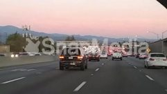 Asphalt, Automobile, Building, Bumper, Car, City, Freeway, Highway, License Plate, Machine, Nature, Outdoors, Plant, Road, Sedan, Street, Tarmac, Town, Traffic Jam, Transportation, Tree, Urban, Vehicle, Wheel