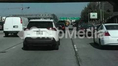 Automobile, Building, Bumper, Car, Car Dealership, City, Coupe, Freeway, Highway, Human, Intersection, License Plate, Machine, Overpass, Parking, Parking Lot, Person, Road, Sedan, Sports Car, Street, Town, Traffic Jam, Transportation, Urban, Vehicle