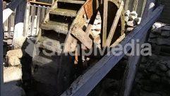 Banister, Building, Handrail, Housing, Lumber, Machine, Nature, Outdoors, Plywood, Porch, Rail, Railing, Railway, Rust, Slate, Spoke, Staircase, Tire, Train Track, Transportation, Vehicle, Water, Wheel, Wood
