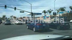 Vehicle,Utility Pole,Traffic Light,Street,Sedan,Road,Parking,Gas Station,Car,Automobile