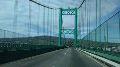 Architecture, Asphalt, Automobile, Bridge, Building, Bumper, Car, City, Freeway, Highway, Metropolis, Overpass, Path, Road, Sedan, Street, Suspension Bridge, Tarmac, Town, Transportation, Urban, Vehicle