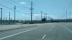 Asphalt, Automobile, Bridge, Building, Cable, Car, Electric Transmission Tower, Freeway, Highway, Intersection, Power Lines, Road, Tarmac, Transportation, Utility Pole, Vehicle