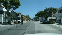 Building, City, Urban, Town, Street, Road, Person, Human, Neighborhood, Vehicle, Transportation, Bike, Bicycle, Automobile, Car