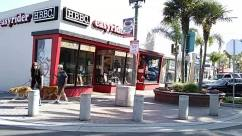 Person, Human, Clothing, Apparel, Shop, Urban, Road, Building, Street, City, Town, Pedestrian, Restaurant, Transportation, Car