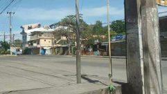 Person, Human, Road, Utility Pole, Urban, Town, Building, City, Street, Machine, Wheel, Path, Vehicle, Transportation, Lamp Post
