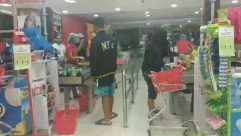 Person, Apparel, Clothing, Shop, Shorts, Market, Grocery Store, Supermarket, Shopping, Indoors, cashier, pushcart
