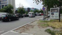 Automobile, Car, Vehicle, Transportation, Person, Road, Building, City, Urban, Street, Town, Wheel, Machine, Path, Parking