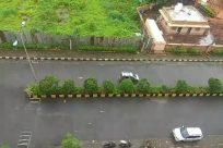 Vehicle, Water, Automobile, Car, Building, Plant, Vegetation, Road, Landscape, River, Boat, Flood, Hotel, Bridge, Land