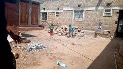 Bench, Furniture, Shoe, Footwear, Flagstone, Pants, Path, Soil, Walkway, Building, Slate, Yard, Shorts, Countryside, Rural