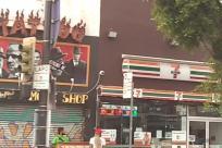 Shop, Vehicle, Van, Lamp Post, Building, Text, Symbol, Light, Traffic Light, Food, Meal, Sign, Word, Alphabet, Gate