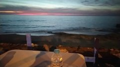 Furniture, Water, Sea, Ocean, Shoreline, Sky, Table, Dining Table, Bottle, Landscape, Panoramic, Sunrise, Chair, Horizon, Red Sky