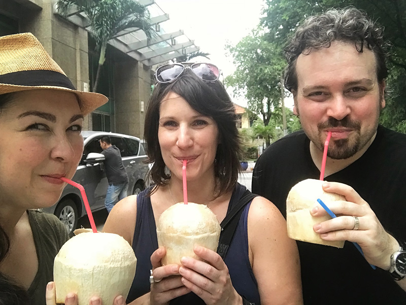 drinking out of coconuts - vietnam