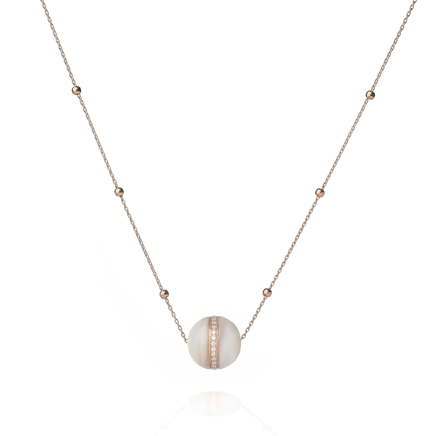 Cabochon Necklace by Dreamboule in 18K Rose Gold with White Diamonds and White Mother of Pearl ($3,600).