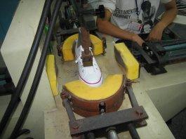 Vulcanized shoe sole pressing