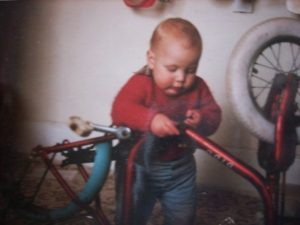 Me as a toddler, already into my bicycle maintenance!