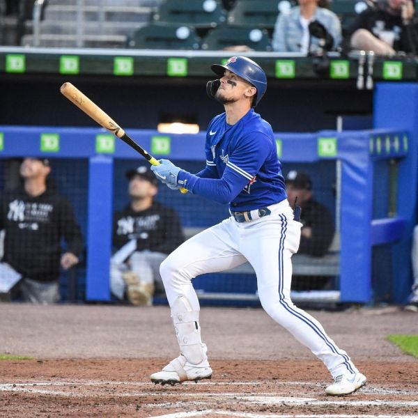 A Blue Jays player watches his hit during a game in the MLB AL East division