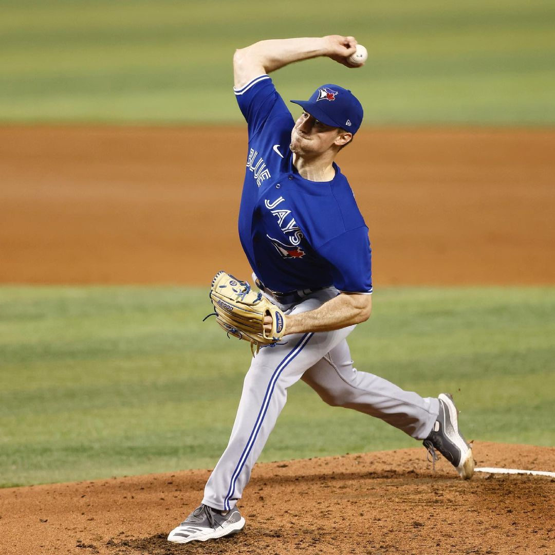 Toronto Blue Jays player Ross Stripling throws a pitch from the mound against Miami