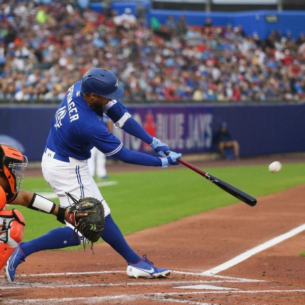 Blue Jays player George Springer hits a homerun in Friday's 6-5 loss to Baltimore