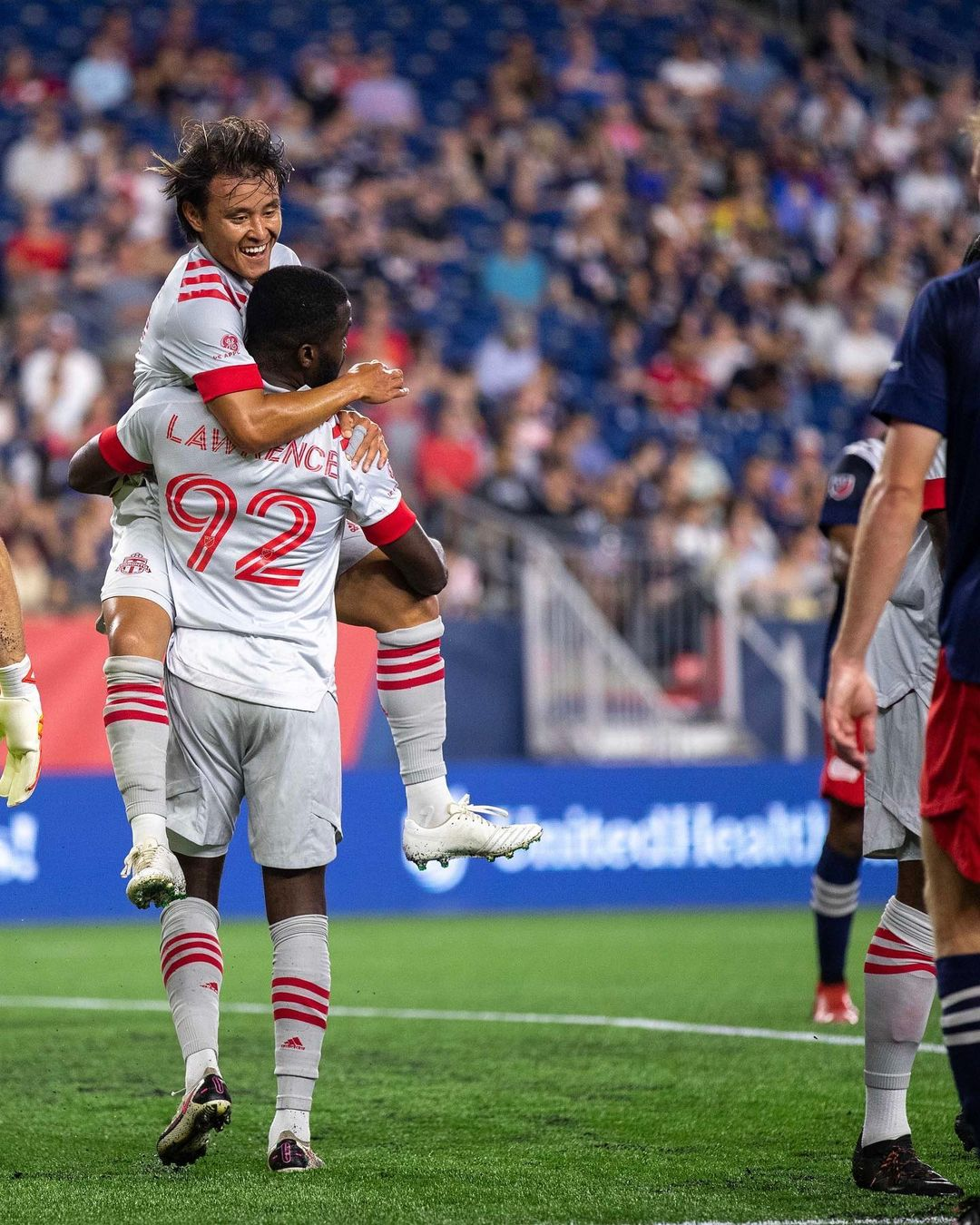 Toronto FC players embrace in celebration of a goal