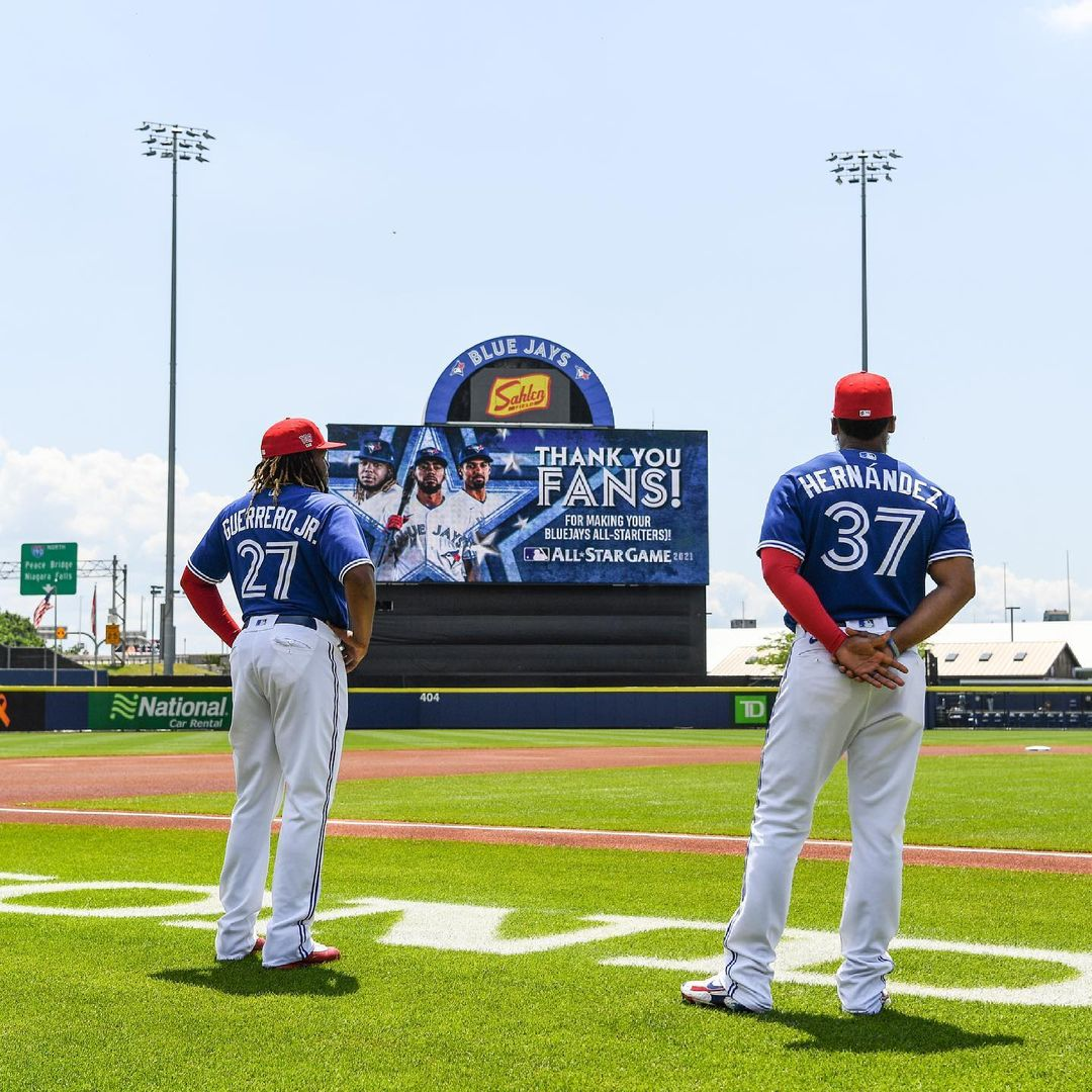 Blue Jays players Vladimir Guerrero Jr. and Teoscar Hernandez look at a sign announcing their All Star game selection