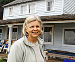 Author Frances Wood outside her family's historic cabin on Whidbey Island