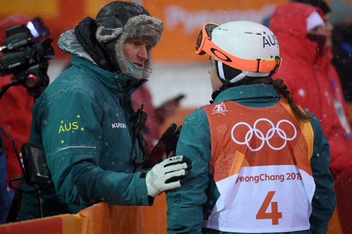Britteny Cox of Australia speaks with her coach Steve Desovich (left) after completing her run in the Ladies Moguls Finals at Phoenix Snow Park during the PyeongChang 2018 Winter Olympic Games, in PyeongChang, South Korea, Sunday, February 11, 2018. (AAP Image/Dan Himbrechts)