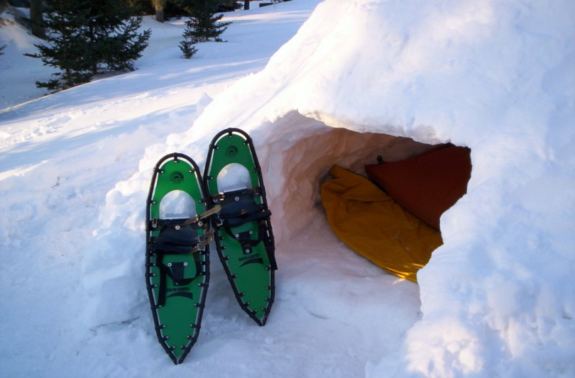 snowshoes outside of a quinzhee