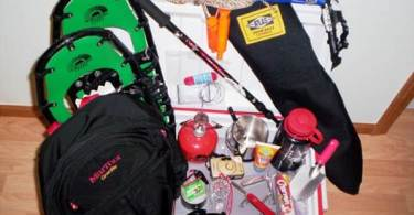 what to bring snowshoeing: close up of items laid on cooler