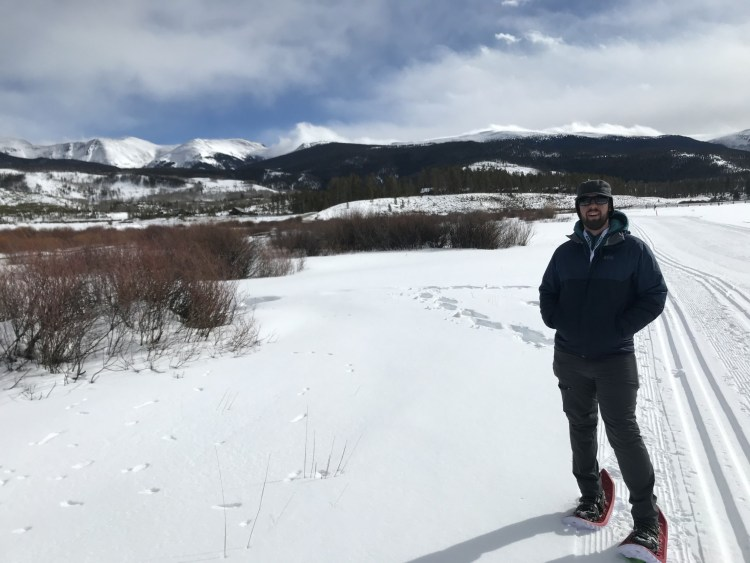 man standing on trail in Crescent Moon Eva Snowshoes