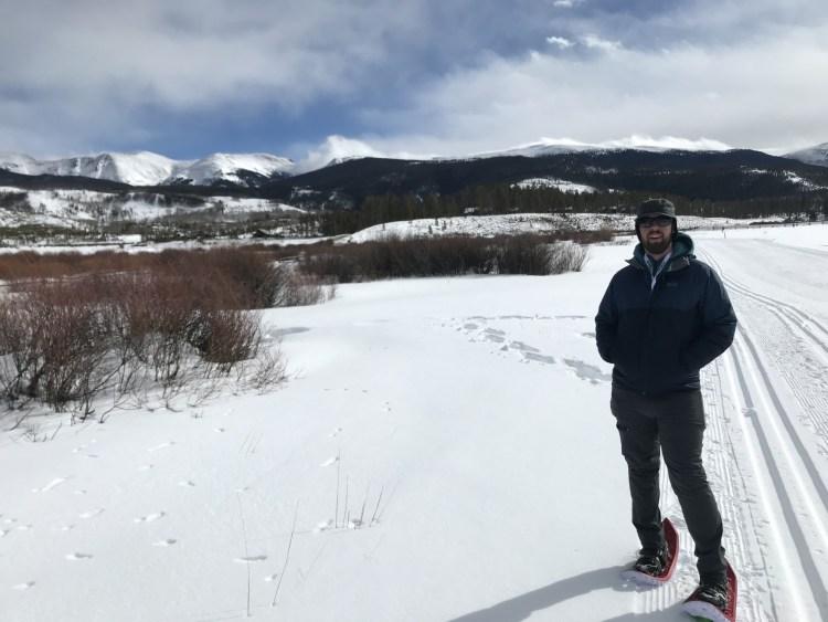 Man Standing on Eva Crescent Moon Snowshoe Trail