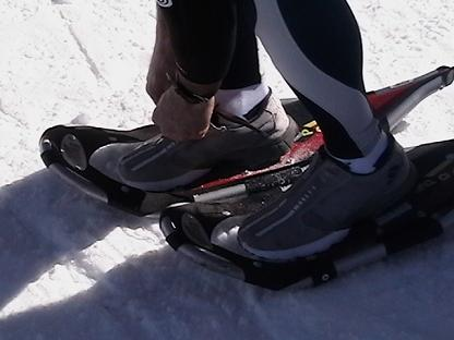 strapping snowshoes on feet