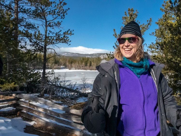 participant smiling after size-inclusive snowshoeing outing